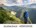 male hiker on a mountain summit ... | Shutterstock . vector #658410436