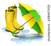 gumboots and open umbrella.... | Shutterstock .eps vector #658447435