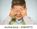 young boy covering his eyes | Shutterstock . vector #65844973