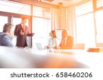 mature businessman discussing... | Shutterstock . vector #658460206