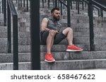 enjoying music after good run.... | Shutterstock . vector #658467622