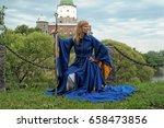 woman in a medieval blue dress...   Shutterstock . vector #658473856