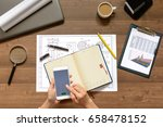 girl is sitting at table with... | Shutterstock . vector #658478152