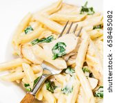 Small photo of Chicken Alfredo Pasta with Spinach. Macro. Selective focus.