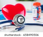 red toy heart and stethoscope... | Shutterstock . vector #658490506