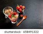 healthy breakfast. granola with ... | Shutterstock . vector #658491322