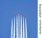 Small photo of HELSINKI, FINLAND - JUNE 9, 2017: Red Arrows group performing in a public air show in Helsinki