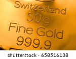 the surface of minted gold bar... | Shutterstock . vector #658516138
