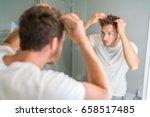 hair loss man looking in... | Shutterstock . vector #658517485