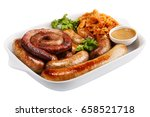 Sausage On A White Plate With...