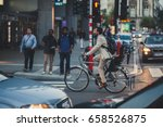 Man In Suit On A Bike Cycling...