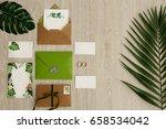 wedding rings near fern leaf ... | Shutterstock . vector #658534042