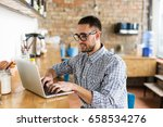 happy man working on laptop. in ... | Shutterstock . vector #658534276