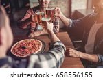 cheers  side view of three male ... | Shutterstock . vector #658556155