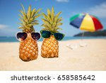 couple of attractive pineapples ... | Shutterstock . vector #658585642