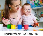 mom and daughter paint on... | Shutterstock . vector #658587202