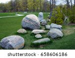 Small photo of A simulator for the development of coordination and dexterity, stones laid out on the lawn in the park