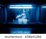 workers and machinery in a... | Shutterstock . vector #658641286