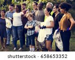 diverse group of people pick up ... | Shutterstock . vector #658653352