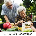 senior adult couple preparing a ... | Shutterstock . vector #658674865
