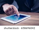 mans hand touching tablet... | Shutterstock . vector #658696042