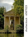 Small photo of Greek temple with a statue of the god Aeklepios (Aesculapius) in Villa Borghese, Rome