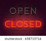 neon closed sign on brick wall... | Shutterstock .eps vector #658715716