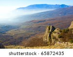 Mountain landscape with fog in vally - stock photo
