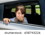 young woman getting carsickness. | Shutterstock . vector #658743226
