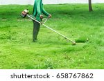 man worker cutting  grass with... | Shutterstock . vector #658767862