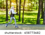 happy fit old woman running... | Shutterstock . vector #658773682