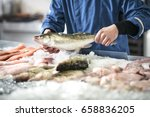 fishmonger selling fish