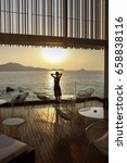 Small photo of Woman standing on the balcony watching beautiful aegean sea view.Aegean sea view from apartment suite or hotel room.Holiday and relaxation concept.Leisure and tranquility