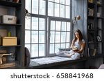 woman reading book at home in...   Shutterstock . vector #658841968