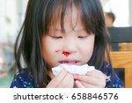 little asian girl wipe her... | Shutterstock . vector #658846576