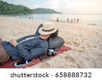 young asian man lying on the... | Shutterstock . vector #658888732