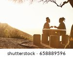couple sitting at a table... | Shutterstock . vector #658889596