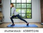attractive asia woman doing... | Shutterstock . vector #658895146