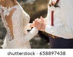 White Bridal Couple At Wedding...
