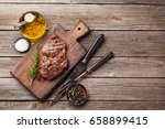 grilled beef steak with spices... | Shutterstock . vector #658899415