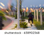 a child riding a bicycle in the ... | Shutterstock . vector #658902568