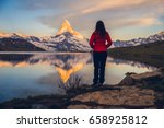 girl admiring the swiss alps... | Shutterstock . vector #658925812
