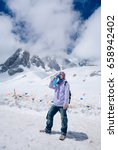 Small photo of Climber breathing with mini portable oxygen cylinder to avoid and treat High Altitude Sickness symptom