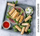 fried spring rolls with red and ... | Shutterstock . vector #658963048