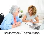 mature woman helping assisted... | Shutterstock . vector #659007856