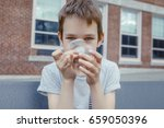 boy looking at a spinning... | Shutterstock . vector #659050396