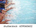 leg shot of kid at swimming... | Shutterstock . vector #659060602