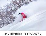good skiing in the snowy... | Shutterstock . vector #659064346