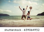 couple lover jump on the sand... | Shutterstock . vector #659064952