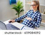 tired pregnant woman working in ...   Shutterstock . vector #659084092